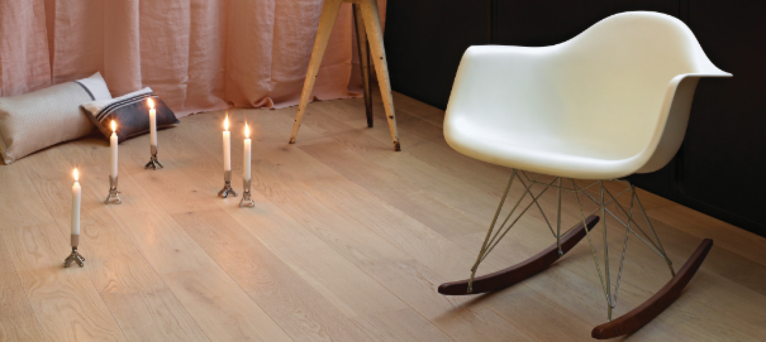What types of wood flooring can be installed with underfloor heating?